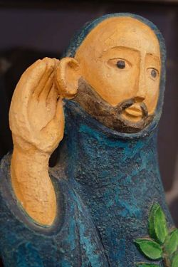 listening monk, polychrome plaster statue